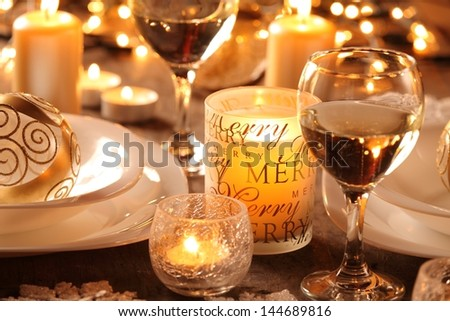 Detail of table with holiday setting and Christmas decorations - stock photo
