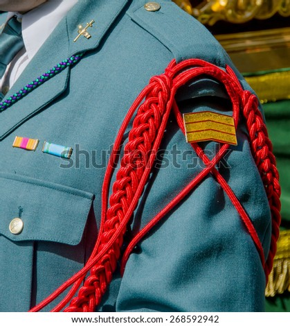 Detail of the aiguillette in the uniform of the spanish Civil Guard. Guardia Civil. Spain - stock photo