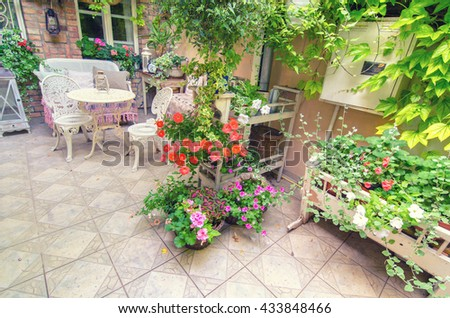 Detail of the beautiful home garden in spring, full of flowers.