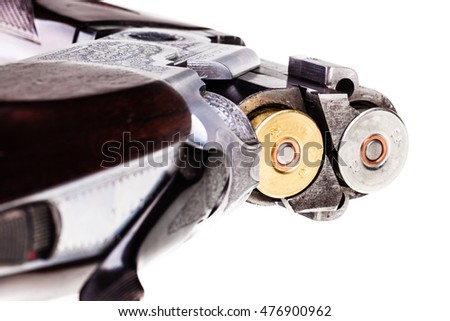 detail of the breech of a classic vertical over-under double barreled shotgun isolated over a white background
