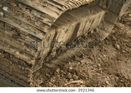 Detail of the caterpillar track of a heavy construction machine. - stock photo