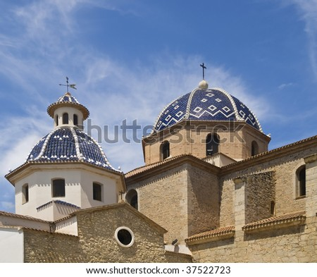 Detail of the cathedral of Altea, located in the Costa Blanca of Spain, with two domes covered with tiles - stock photo