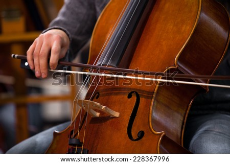 Detail of the cello in the hands of a musician  - stock photo