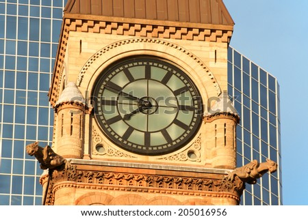 Detail of the clock tower of Toronto Old City Hall in the sunset light. Toronto, Ontario, Canada. - stock photo