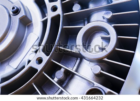 Detail of the electric motor housing. The back cover with a plurality of fins for cooling. Powder coated, granular surface. - stock photo