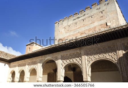 Detail of the exquisite ornamentation of stuccos of the archway of the south portico in the Court of the Myrtles, in The Alhambra, Granada, Spain - stock photo