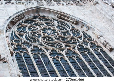 Detail of the facade big window Milan cathedral in Milan, Italy - stock photo