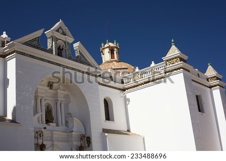 Detail of the facade of the Basilica of Our Lady of Copacabana in the small tourist town along the Titicaca Lake in Copacabana, Bolivia  - stock photo