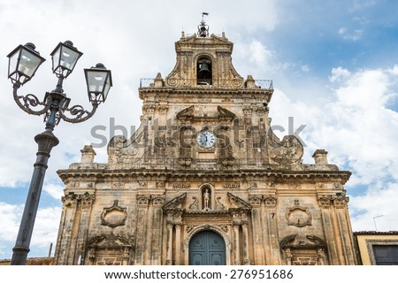 Detail of the facade of the church of San Sebastiano against a cloudy sky in Palazzolo Acreide, Siracusa, Sicily, Italy