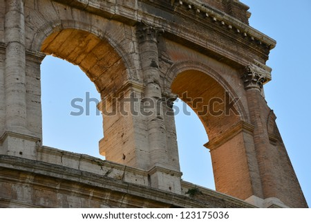 detail of the famous coliseum in rome - stock photo