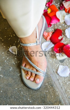 detail of the foot and wedding shoe - stock photo