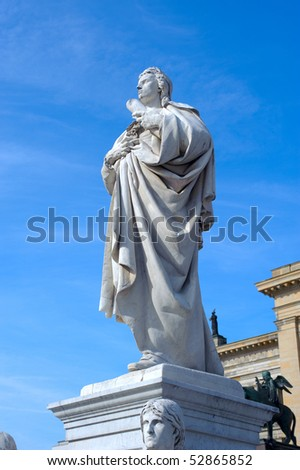 Detail of the French Dome and the statue of german poet Friedrich Schiller in Gendarmenmarkt Square in Berlin. The church was contructed by the Huguenot community between 1701 and 1705.