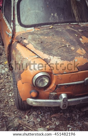 Detail of the front headlight of an old car,hood - stock photo