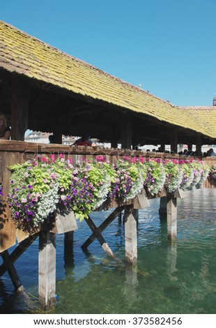 Detail of the historic Chapel bridge (Famous covered wooden footbridge) in Lucerne, Switzerland  - stock photo