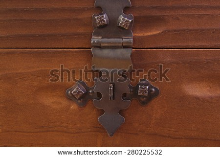 Detail of the lock on an old vintage trunk - stock photo