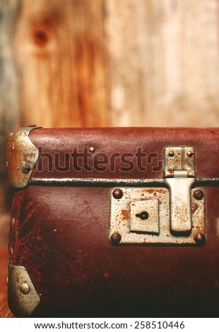 Detail of the lock on an old vintage trunk, toned image - stock photo