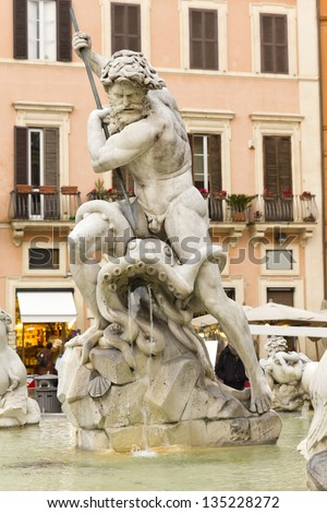 Detail of the Neptune fountain in Piazza Navona, Rome, Italy. - stock photo
