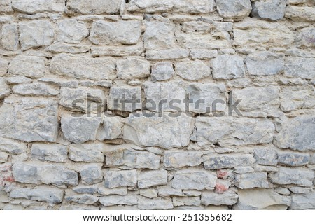 Detail of the old stone wall texture - stock photo