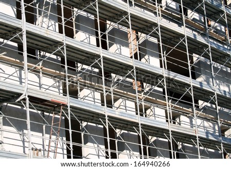 detail of the scaffold building for the construction of buildings in the construction site - stock photo