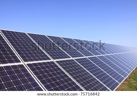 Detail of the Solar Power Station in the green Nature - stock photo