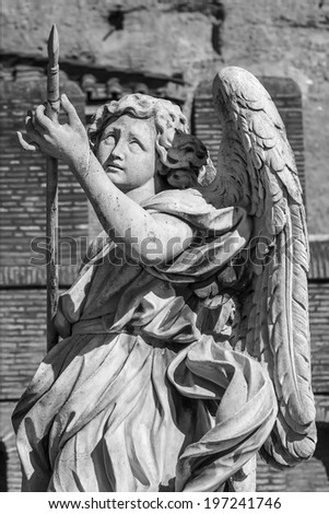 Detail of the statue of the Angel with the lance on the Sant'Angelo bridge in Rome - stock photo