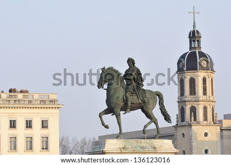 detail of the statue that dominates the square in downtown bellecour lyon, france - stock photo