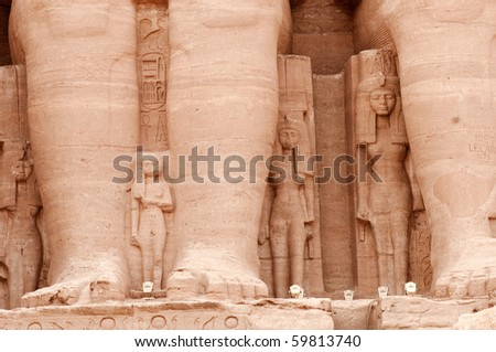 Detail of the temple of Ramses II in Abu Simbel showing the wife and children of the pharaoh.  Built in 1274-1244 BC. - stock photo