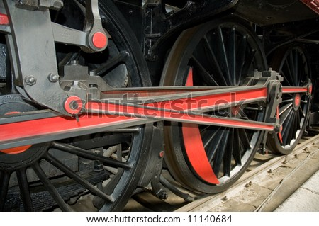 Detail of the wheels of  a steam locomotive. - stock photo