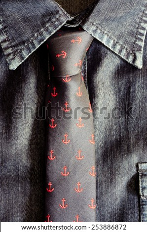 Detail of tie and denim jeans vintage shirt - stock photo