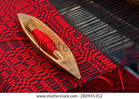 Detail of traditional vintage belorussian weaving hand loom with wool close up