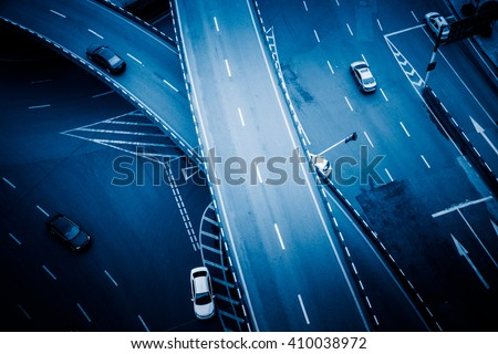 detail of traffic on chongqing caiyuanba overpass,blue toned image. - stock photo