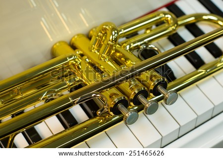 Detail of trumpet lying on the piano  - stock photo