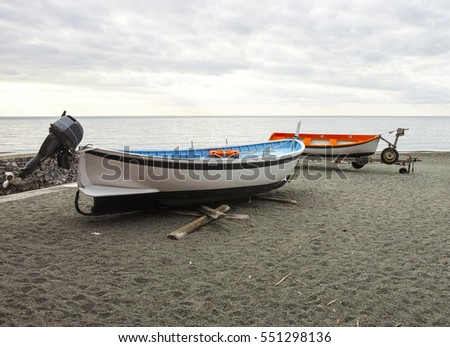 detail of two boats on the beach in winter time