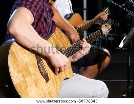Detail of two guitar players on stage during the concert. - stock photo