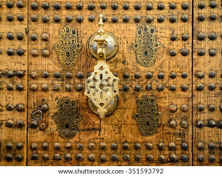 Detail of unusually ornamented Moroccan architecture. Knocker to the door - stock photo