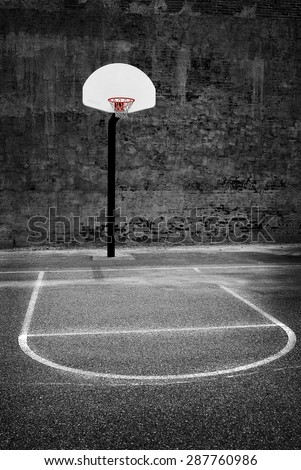 Detail of urban basketball hoop inner city innercity wall and asphalt in outdoor park - stock photo