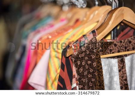 Detail of Vintage clothes for sale inside a shop  - stock photo