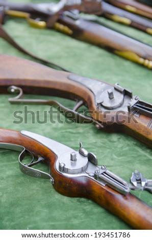 Detail of vintage flintlock military rifles - stock photo