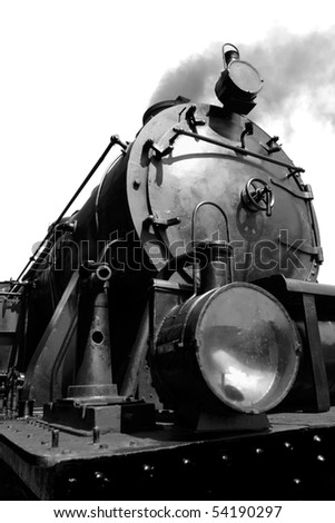 Detail of Vintage steam engine, working, with smoke - converted to black and white - stock photo