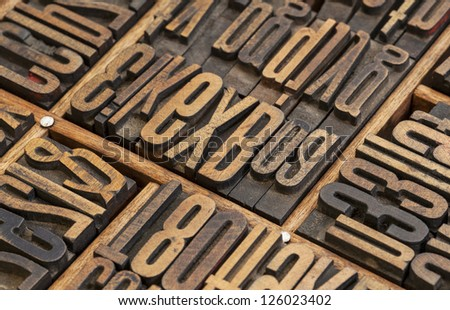 detail of vintage typesetter drawer with  letterpress wood type printing blocks - stock photo