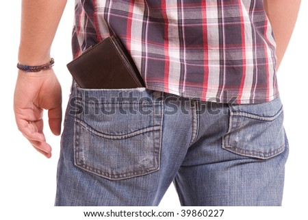 Detail of wallet in man's back pocket - stock photo