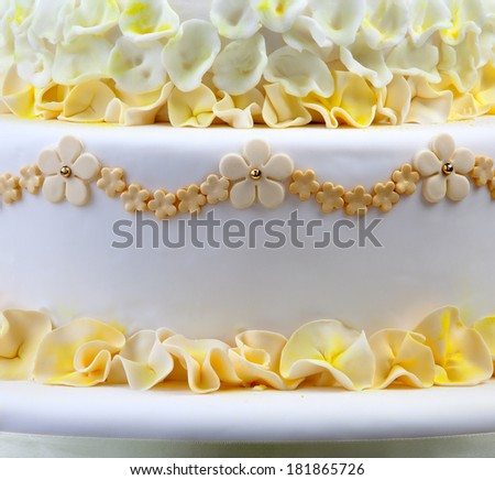 Detail of wedding cake with flowers - stock photo