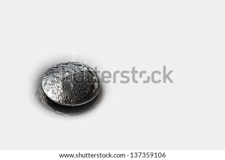 Detail of wet plughole of a bathtub - stock photo