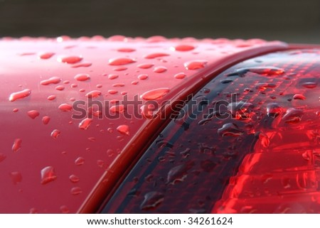 Detail of wet red car - stock photo