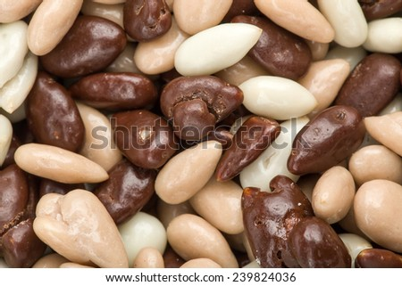 detail of white and brown chocolate almonds background