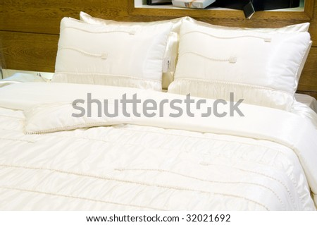 Detail of white bed - stock photo