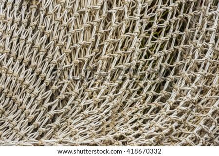 Detail of white fishing net. - stock photo