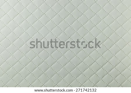detail of white sewn leather - stock photo