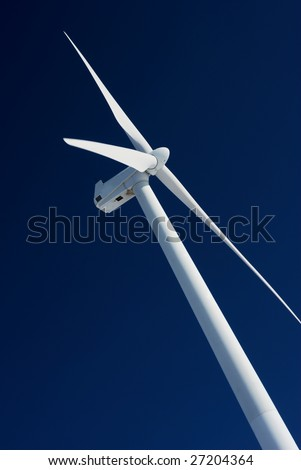 Detail of wind turbine with deep blue sky - stock photo