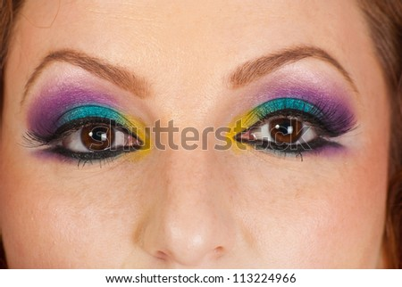 Detail of woman eyes with colorful makeup